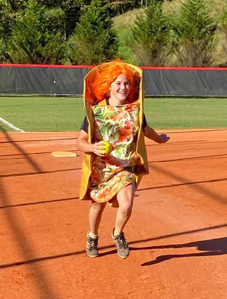 Anna Kurto races as a taco in costume practice.
