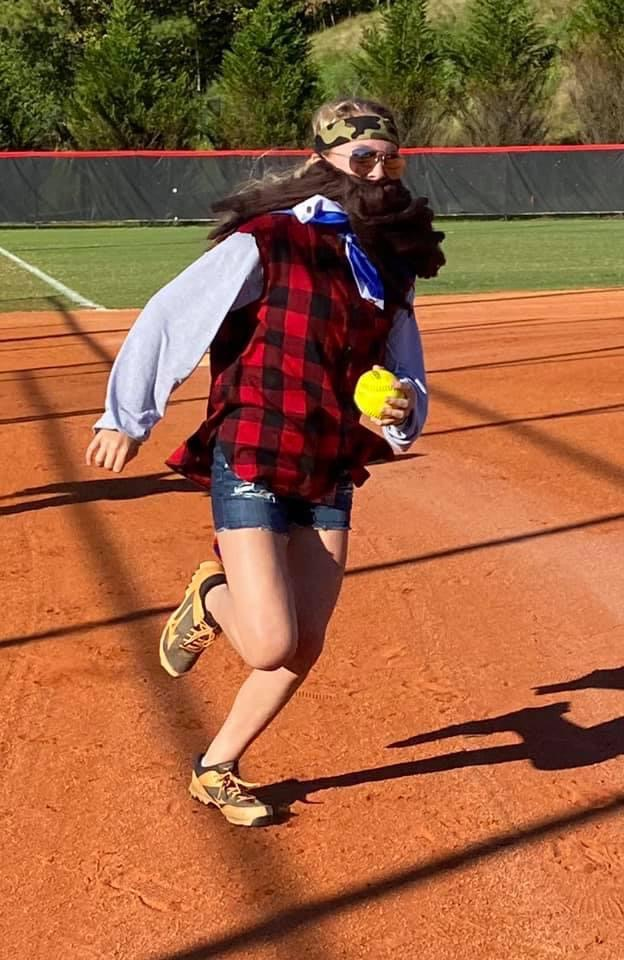 Emily Gould races home in costume practice.