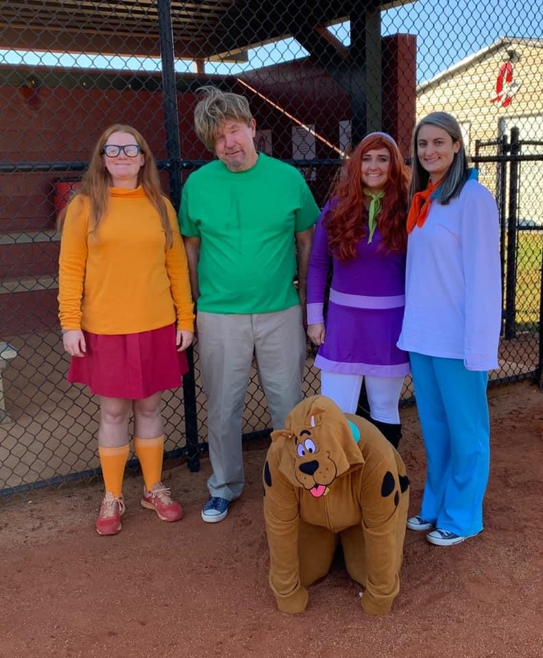 The coaching staff dresses up for the team's annual costume practice.