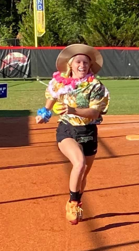 Sarah Maloney races around the bases in costume practice.