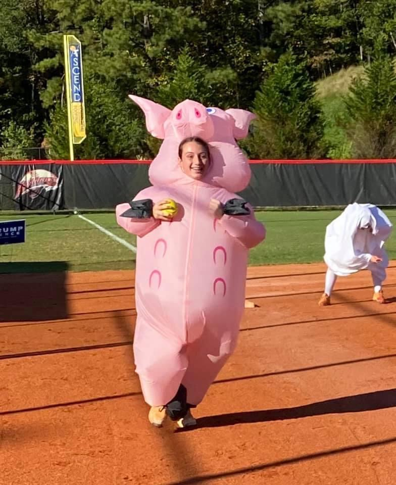 Emma Pesavento races home in a blow - up pig costume in practice.
