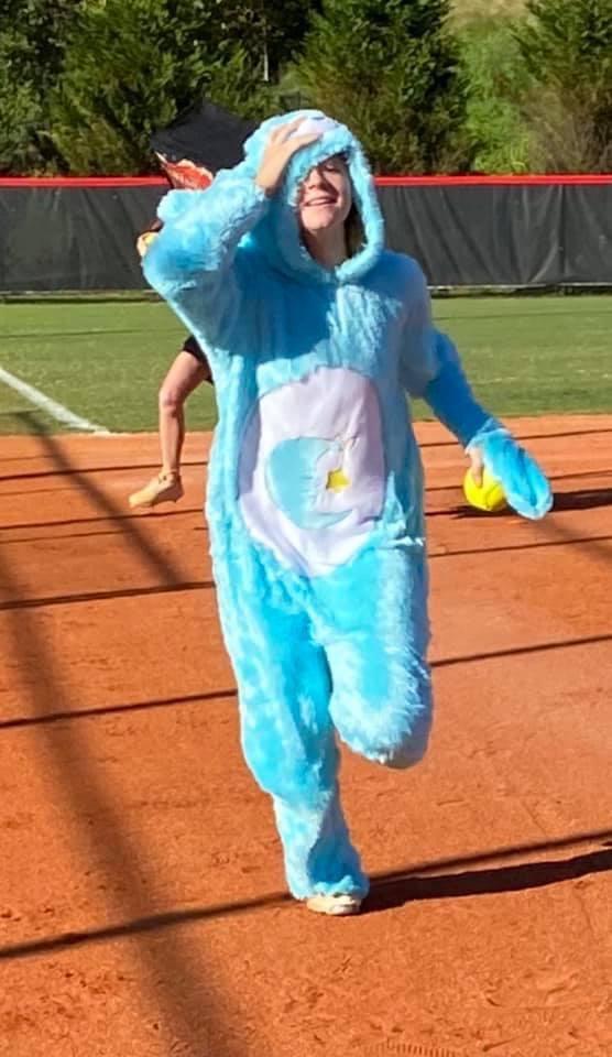 Avery Hefner races around the bases in a onesie in costume practice.