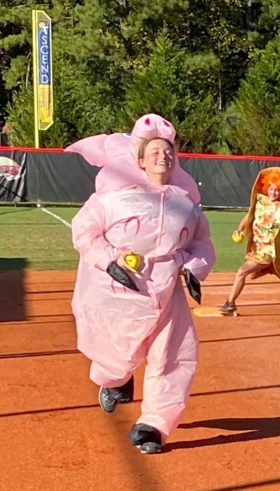 Elyse Kesho races Anna Kurto around the bases.
